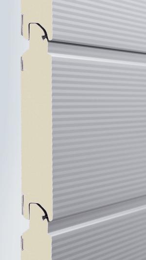 HS 7030 PU : cette porte à enroulement conçue par Hörmann, est équipée d'une barrière photoélectrique de sécurité directement intégrée au cadre dormant, et livrée en aluminium blanc RAL 9006.