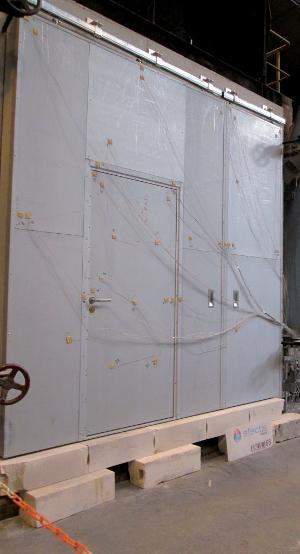 Essai EI porte coulissante avec portillon intégré. ©Portafeu